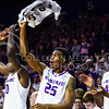 Sophomore forward Wesley Iwundu and the rest of the K-State bench celebrate following a layup by senior forward Nino Williams with 20 seconds left in the second half of the Wildcats' 63-53 defeat of the Cowboys January 24, 2015, in Bramlage Coliseum. (Parker Robb | The Collegian)
