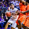 Junior guard Justin Edwards attempts to advance past Oklahoma State forward Le'Bryan Nash in the second half of the Wildcats' 63-53 defeat of the Cowboys January 24, 2015, in Bramlage Coliseum. (Parker Robb | The Collegian)