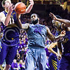West Virginia forward Nathan Adrian (11) steals the ball from K-State senior forward Thomas Gipson (42) as Gipson looses control of the ball beneath the basket in the second half of the Wildcats' brutal 59-65 loss to the #17-ranked Mountaineers January 27, 2015, in Bramlage Coliseum. Adrian lobbed the ball toward a teammate, but Gipson redeemed himself by snatching the ball out of midair. (Parker Robb | The Collegian)