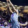Sophomore forward Wesley Iwundu makes one last reaching grasp at victory as he puts in a reaching tip shot to cut the score to 59-64 with sixteen seconds remaining in the second half of the Wildcats' brutal 59-65 loss to the #17-ranked Mountaineers January 27, 2015, in Bramlage Coliseum. (Parker Robb | The Collegian)