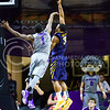 Sophomore guard Jevon Thomas attempts to block West Virginia guard Juwan Staten's missed layup in the second half of the Wildcats' brutal 59-65 loss to the #17-ranked Mountaineers January 27, 2015, in Bramlage Coliseum. (Parker Robb | The Collegian)
