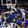 West Virginia guard Jaysean Paige slams in a dunk after getting past sophomore guard Jevon Thomas (1) to put the Mountaineers up 44-40 in the second half of the Wildcats' brutal 59-65 loss to the #17-ranked Mountaineers January 27, 2015, in Bramlage Coliseum. (Parker Robb | The Collegian)