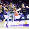 Sophomore forward Wesley Iwundu escapes from the full-court press of West Virginia guards Jaysean Paige (0) and Gary Browne (14) in the second half of the Wildcats' brutal 59-65 loss to the #17-ranked Mountaineers January 27, 2015, in Bramlage Coliseum. (Parker Robb | The Collegian)