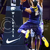 West Virginia guard Jevon Carter sneaks a jumping layup past freshman forward Malek Harris in the second half of the Wildcats' brutal 59-65 loss to the #17-ranked Mountaineers January 27, 2015, in Bramlage Coliseum. (Parker Robb | The Collegian)