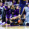 Sophomore guard Jevon Thomas (1) sits up a little dazed as freshman forward Malek Harris continues to fight West Virginia forward Devin Williams for the ball following an onslaught of West Virginia offensive rebounds followed by missed shots in the second half of the Wildcats' brutal 59-65 loss to the #17-ranked Mountaineers January 27, 2015, in Bramlage Coliseum. K-State came away with the jump ball possession. (Parker Robb | The Collegian)