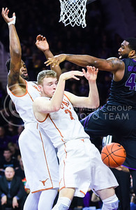 Senior forward Thomas Gipson attempts to get the defensive rebound from Texas forward Connor Lammert (front) and center Prince Ibeh (behind) in the second half of the Wildcats' 57-61 shortcoming at the hands of the #25 Longhorns February 7, 2015, in Bramlage Coliseum. (Parker Robb | The Collegian)
