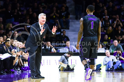 Head coach Bruce Weber relays instructions to sophomore guard Jevon Thomas as senior forward Thomas Gipson (not pictured) shoots free throws in the first half of the Wildcats' 57-61 shortcoming at the hands of the #25 Longhorns February 7, 2015, in Bramlage Coliseum. (Parker Robb | The Collegian)
