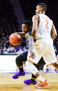 Sophomore guard Jevon Thomas has some trouble with Texas guard Demarcus Holland's size as he tries to find a way to dribble past him in the first half of the Wildcats' 57-61 shortcoming at the hands of the #25 Longhorns February 7, 2015, in Bramlage Coliseum. (Parker Robb | The Collegian)