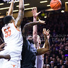 Senior forward Thomas Gipson is fouled by Texas center cameron Ridley as he attempts a layup in the first half of the Wildcats' 57-61 shortcoming at the hands of the #25 Longhorns February 7, 2015, in Bramlage Coliseum. (Parker Robb | The Collegian)