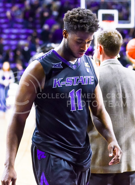 Senior forward Nino Williams walks off the court head hanging low in defeat following K-State's loss to the Texas Longhorns February 7, 2015, in Bramlage Coliseum. (Parker Robb   The Collegian)