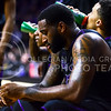 Senior forward Thomas Gipson depressingly sits and listens to head coach Bruce Weber during a timeout in the second half of the Wildcats' 57-61 shortcoming at the hands of the #25 Longhorns February 7, 2015, in Bramlage Coliseum. (Parker Robb | The Collegian)