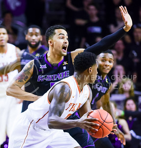 Freshman guard Tre Harris defends against Texas guard Kendal Yancy in the first half of the Wildcats' 57-61 defeat at the hand of the Longhorns February 7, 2015, in Bramlage Coliseum. In the absence of sophomore guard Marcus Foster and freshman forward Malek Harris, Tre Harris played a career high-tying 25 minutes and contributed 12 points, including a 4-of-4 string of three-pointers to erase an 11-point deficit in the first half. (Parker Robb | The Collegian)