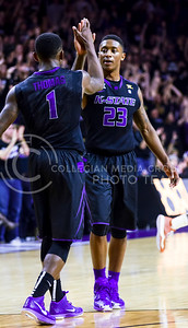 Sophomore guard Nigel Johnson (23) high-fives sophomore guard Jevon Thomas (1) amidst thunderous cheers from the crowd after draining a three-pointer in the second half of the Wildcats' 57-61 shortcoming at the hands of the #25 Longhorns February 7, 2015, in Bramlage Coliseum. (Parker Robb | The Collegian)