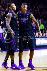 Sophomore guard Nigel Johnson (23) hugs sophomore guard Jevon Thomas amidst thunderous cheers from the crowd after draining a three-pointer in the second half of the Wildcats' 57-61 shortcoming at the hands of the #25 Longhorns February 7, 2015, in Bramlage Coliseum. (Parker Robb | The Collegian)