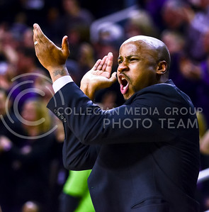 Assistant coach Chester Frazier encourages the student section to get as loud as possible as the Wildcats attempt an other furious comeback in the final minutes of the second half of the Wildcats' 57-61 shortcoming at the hands of the #25 Longhorns February 7, 2015, in Bramlage Coliseum. (Parker Robb | The Collegian)
