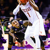 Sophomore guard Jevon Thomas peeks around Texas guard Isaiah Taylor as Taylor looks to pass in the first half of the Wildcats' 57-61 shortcoming at the hands of the #25 Longhorns February 7, 2015, in Bramlage Coliseum. (Parker Robb | The Collegian)