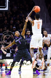 Sophomore guard Jevon Thomas defends against a three-point shot from Texas guard Kendal Yancy in the first half of the Wildcats' 57-61 shortcoming at the hands of the #25 Longhorns February 7, 2015, in Bramlage Coliseum. (Parker Robb | The Collegian)