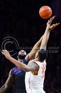 Senior forward Thomas Gipson attempts to snatch the opening tipoff from Texas center Cameron Ridley in the first half of the Wildcats' 57-61 shortcoming at the hands of the #25 Longhorns February 7, 2015, in Bramlage Coliseum. (Parker Robb | The Collegian)