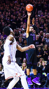 Freshman guard Tre Harris drains his third three-pointer in a row to cut the Wilcats' deficit to four points in the first half of the Wildcats' 57-61 shortcoming at the hands of the #25 Longhorns February 7, 2015, in Bramlage Coliseum. Harris' three in a row from behind the arc brought K-State back from a 12-point deficit late in the first half, and after a pair of free throws from sophomore guard Jevon Thomas, the Wilcats and Longhorns went into the intermission tied at 27 apiece. (Parker Robb | The Collegian)