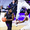 Senior forward Nino Williams looks to pass as Texas center Prince Ibeh (44) and guard Isaiah Taylor (right) look for the steal in the second half of the Wildcats' 57-61 shortcoming at the hands of the #25 Longhorns February 7, 2015, in Bramlage Coliseum. (Parker Robb | The Collegian)