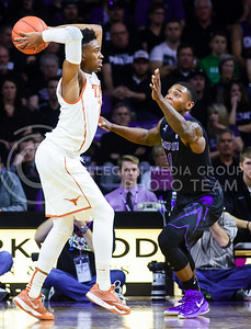 Sophomore guard Jevon Thomas defends against a pass from Texas guard Isaiah Taylor in the first half of the Wildcats' 57-61 shortcoming at the hands of the #25 Longhorns February 7, 2015, in Bramlage Coliseum. (Parker Robb | The Collegian)