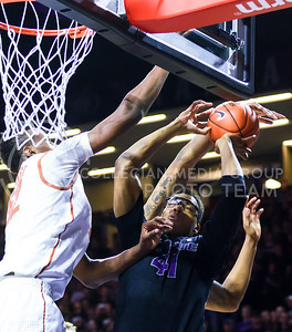 Junior forward Stephen Hurt has his shot blocked by Texas forward Myles Turner in the first half of the Wildcats' 57-61 shortcoming at the hands of the #25 Longhorns February 7, 2015, in Bramlage Coliseum. (Parker Robb | The Collegian)
