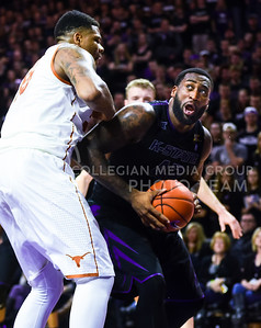 Sophomore forward Thomas Gipson breaks past Texas center Cameron Ridley as he goes for a layup in the first half of the Wildcats' 57-61 shortcoming at the hands of the #25 Longhorns February 7, 2015, in Bramlage Coliseum. (Parker Robb | The Collegian)