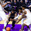 Senior forward Nino Williams dives for a fumbled ball that was knocked out of his hands before Texas players can get to it in the second half of the Wildcats' 57-61 shortcoming at the hands of the #25 Longhorns February 7, 2015, in Bramlage Coliseum. (Parker Robb | The Collegian)