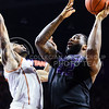 Senior forward Thomas Gipson goes up against Texas guard Isaiah Taylor for what would have been the game-tying basket in the final seconds of the Wildcats' 57-61 shortcoming at the hands of the #25 Longhorns February 7, 2015, in Bramlage Coliseum. Gipson finished the game making 0-of-7 field goals. (Parker Robb | The Collegian)