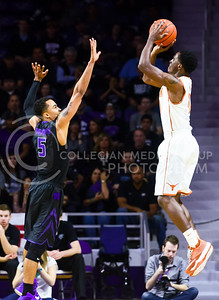 Freshman guard Tre Harris defends a shot from Texas guard Kendal Yancy in the second half of the Wildats' loss to the Longhorns February 7, 2015, in Bramlage Coliseum. (Parker Robb | The Collegian)