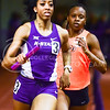Freshman sprinter Keiteyana Parks carries the baton for the second leg of the women's 4x400m relay at the DeLoss Dodds Invitational track & field meet January 24, 2015, in Ahearn Fieldhouse. (Parker Robb | The Collegian)