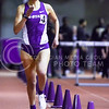 Senior distance runner Laura Galvan approaches the final lap as she leads the women's one mile run at the K-State Open track & field meet February 20, 2015, at Ahearn Fieldhouse. (Parker Robb | The Collegian)