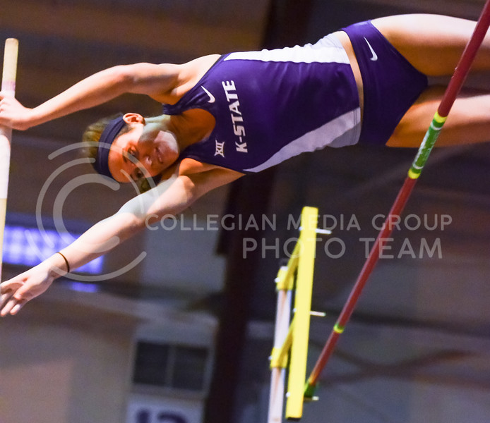 Freshman pole vaulter Megan Vanderpool arches over the bar at the K-State Open track & field meet February 20, 2015, at Ahearn Fieldhouse. Vanderpool placed first in the pole vault at this weekend's TCU Invitational meet, clearing a height of 3.46m. (Parker Robb | The Collegian)