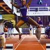 Junior jumper Alyssa Kelly soars throught the air to a long jump of 5.62m at the K-State Open track & field meet February 20, 2015, at Ahearn Fieldhouse. (Parker Robb | The Collegian)