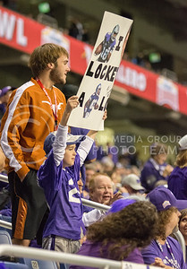 A K-State fan holds a sign up during the 2015 Alamo Bowl game against UCLA on Jan. 2, 2015. (George Walker | The Collegian)