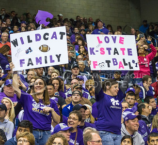 Many fans created signs showing their love for Kansas State University. The wildcat on the left spun around, while the sign on the right lit up. (Mason Swenson | The Collegian)