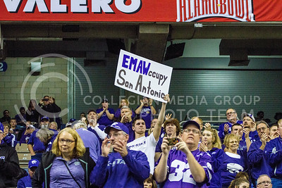 During pre-game, Kansas State University fan held up signage to show support as the football team takes the field. The Wildcats played in the Valero Alamo Bowl against UCLA on Jan. 2. (Mason Swenson | The Collegian)