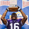 Senior wide receiver Tyler Lockett lifts the trophy he received for winning the Valero Alamo Bowl Sportsmanship Award in No. 11 K-State's 35-40 Loss to No. 14 UCLA January 2, 2015, in the Alamodome in San Antonio, Texas. Lockett finished his legendary K-State career with the K-State all-time records in receptions (249), receiving yards (3,552), receiving touchdowns (29) and kickoff return yards (2,193). Over his four-year career, he averaged 17.3 yards every time he touched the ball. (Parker Robb | The Collegian)