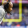 Wide receivers coach Andre Coleman intently watches his players as the Wildcats try to mount a 25 point comeback in the fourth quarter of the Valero Alamo Bowl January 2, 2015, in the Alamodome in San Antonio, Texas. (Parker Robb | The Collegian)