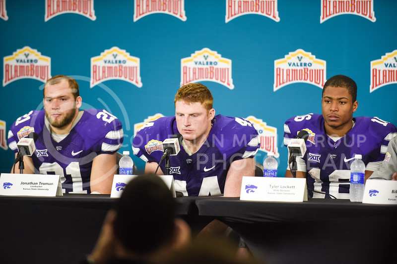 From left to right, senior linebacker Jonathan Truman, senior defensive end Ryan Mueller and senior wide receiver Tyler Lockett despairingly answer questions from the media following their close loss to UCLA in the Valero Alamo Bowl to close out the 2014 season and their K-State careers January 2, 2015, in the Alamodome in San Antonio, Texas. (Parker Robb | The Collegian)