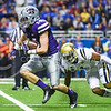 Senior wide receiver Curry Setxon evades a tackle from UCLA defensive back Ishmael Adams after a reception in the fourth quarter of No. 11 K-State's 35-40 loss to No. 14 UCLA in the Valero Alamo Bowl January 2, 2015, in the Alamodome in San Antonio, Texas. (Parker Robb | The Collegian)