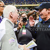 Head coach Bill Snyder and UCLA head coach Jim Mora chat briefly following No. 11 K-State's 35-40 loss to No. 14 UCLA in the Valero Alamo Bowl January 2, 2015, in the Alamodome in San Antonio, Texas. Displeased with the last play of the game, in which K-State defenders jumped over the UCLA offensive line attempting to get the ball from UCLA quarterback Brett Hundley before he kneeled it out, Mora rudely brushed off Snyder's first attempt at a handshake, before returning to Snyder to legitimately shake his hand. K-State fans were enraged at the lack of class shown by Mora. (Parker Robb | The Collegian)