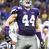 Senior defensive end Ryan Mueller celebrates after the K-State kickoff unit stopped UCLA's kick returner on the 24 yard line in the fourth quarter of No. 11 K-State's 35-40 loss to No. 14 UCLA in the Valero Alamo Bowl January 2, 2015, in the Alamodome in San Antonio, Texas. Mueller finished his K-State career, which he began as a walk-on, with 20.0 sacks, tied for 6th all time at K-State. (Parker Robb | The Collegian)
