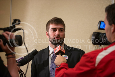 Senior quarterback Jake Waters answers questions from reporters during the Offensive Press Conference on Dec. 31, 2014 at San Antonio.  (Rodney Dimick | The Collegian)