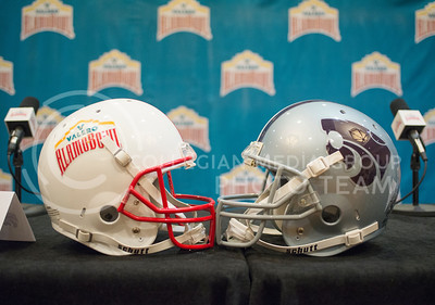 A Valero Alamo Bowl and K-State Wildcat football helmet at the K-State Offensive press conference on Dec. 31, 2014. (George Walker | The Collegian)