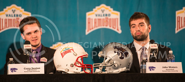 Senior wide receiver Curry Sexton and Senior quarterback Jake Waters listen to a question during the Offensive Press Conference on Dec. 31, 2014 at San Antonio.  (Rodney Dimick | The Collegian)