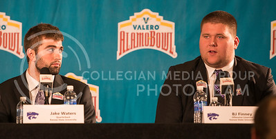 Senior quarterback Jake Waters looks over to senior offensive lineman BJ Finney while Finney responds to a question during the Offensive Press Conference on Dec. 31, 2014 at San Antonio.  (Rodney Dimick | The Collegian)