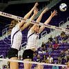 Sophomores Katie Reininger and Katie Brand go up for a block during the Arkansas game on Sept. 4, 2014. (Kandace Griffin | The Collegian)