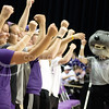 On Sept. 4, 2014 several Kansas State student fans cheer on The Cats at the game vs. Arkansas University. (Kandace Griffin | The Collegian)
