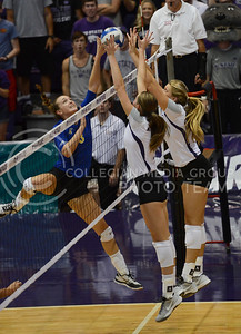 Both teams fight against the ball on Sept. 16, 2014 at Ahearn Field House.  (Rodney Dimick | The Collegian)